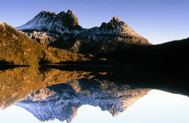 Reflection of mountain on still surface of Dove Lake