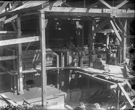 Bricklayers building furnace at E.Z. Co. Zinc Works