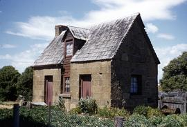 Stone cottage with shingle roof