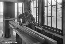 Carpenter in workshop at E.Z. Co. Zinc Works