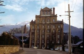 Cascade Brewery building in front of snow-capped mountain