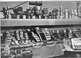 Display of Cadbury chocolate bars, assorted boxed chocolates and tinned items