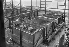 Interior tanks being fitted out in partially constructed building at E.Z. Co. Zinc Works