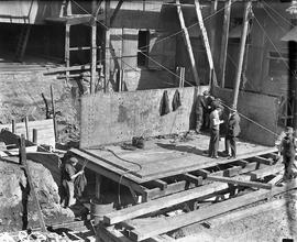 Workers assembling jacket of Derwent Prime furnace at E.Z. Co. Zinc Works