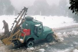 Snow plowing on road to Mount Wellington