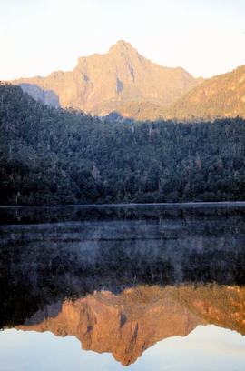 Portrait format view of reflection of Mount Anne on surface of Lake Timk