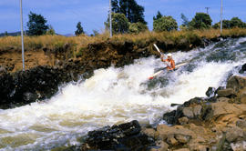 Paddler on whitewater course at Bradys Lake
