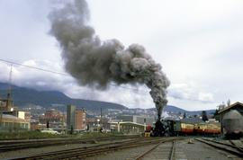 C Class locomotive pulls passenger cars at Hobart Station