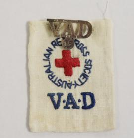 Fabric  Australian Red Cross Society VAD badge with metal VAD badge  attached