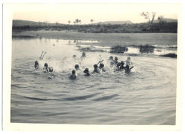 Photograph of aboriginal children swimming in a waterhole
