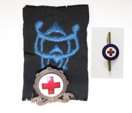Metal Red Cross badges  – one with navy embroidered badge attached