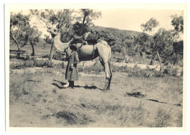 Photograph of Olive Pink and the the camel Quart-pot